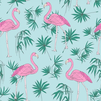 Beautiful tropical seamless pattern with pink flamingo birds and green jungle palm foliage hand drawn on blue background.