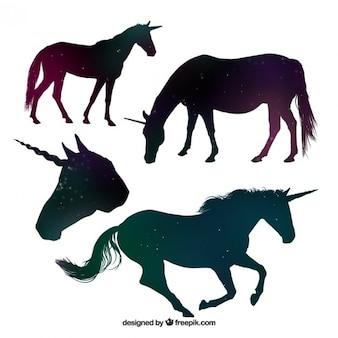 Beautiful unicorn silhouettes made up of stars Premium Vector