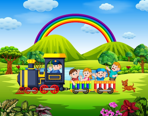Beautiful view with the children inside the train waving under the rainbow
