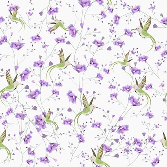 Beautiful violet flower and hummingbird seamless pattern.