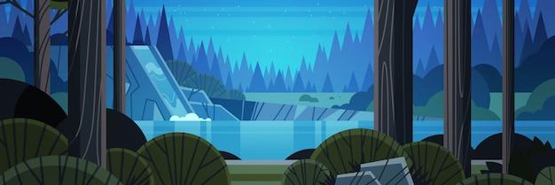 Красивый водопад над скалистым утесом ночь лето лес природа пейзаж