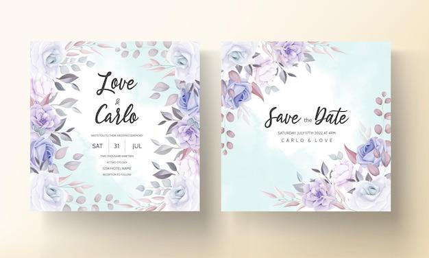 紫色の花の飾りと美しい結婚式の招待カード