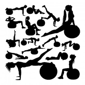 Beautiful woman doing fitness silhouettes