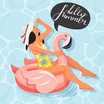Beautiful woman floating and sunbathing on inflatable ring in the shape of flamingo in swimming pool. slogan design