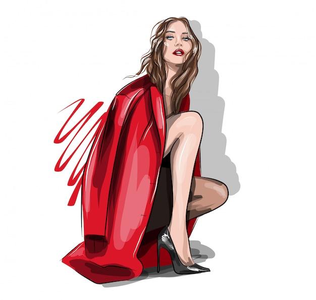 赤いジャケットとハイヒールで美しい女性。座っているポーズの女の子。モデル登場の美少女。ファッションとスタイル。