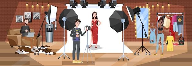 白で写真撮影を行う赤いドレスで美しい女性