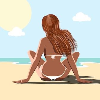 바다의 해변에 앉아 아름 다운 여자