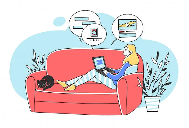 Beautiful woman sitting at sofa with laptop