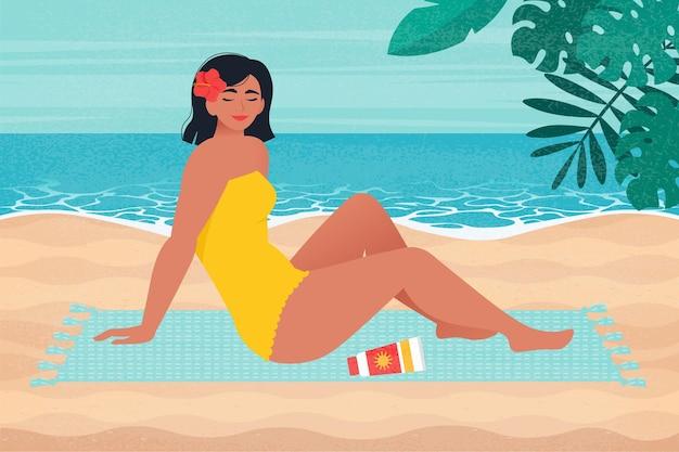해변에서 일광욕하는 아름 다운 여자