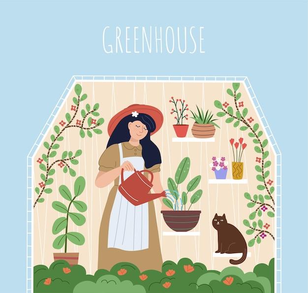 온실에서 식물을 급수하는 아름 다운 여자