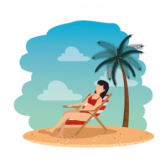 Beautiful woman with swimsuit seated in beach chair on the beach
