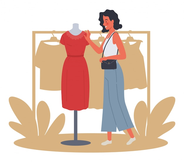 美しい女性のショッピング。女の子は赤いドレスを試します。