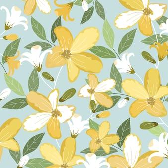 緑の葉と美しい黄色と白の花。
