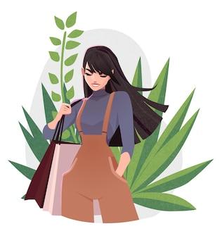 Красивая молодая девушка в модной одежде с концепцией торгового дня сумок