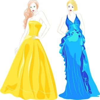 Красивые молодые девушки с длинными волосами в модных вечерних платьях синего и золотого цветов, изолированные на белом фоне