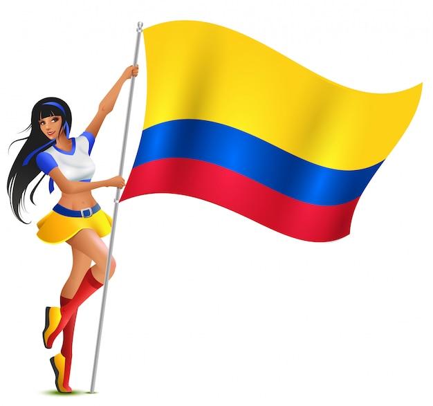 Красивая болельщица футбола молодой женщины держа флаг колумбии