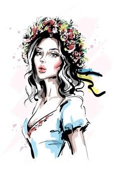 Красивая молодая женщина в цветочном венке