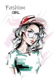 赤い帽子の美しい若い女性
