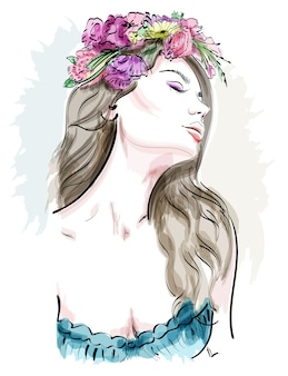 Beautiful young woman with curly hair and flower wreath