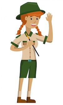 A beautiful zookeeper holding a stick and wave hands