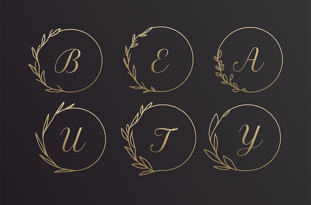Beauty black and gold hand drawn alphabet flower wreath logo frame design set