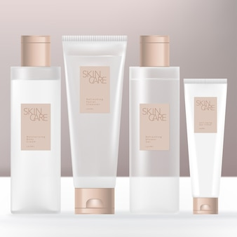 Beauty or skincare transparent cream shampoo gel or cream bottle and tube bundle with beige caps Premium Vector