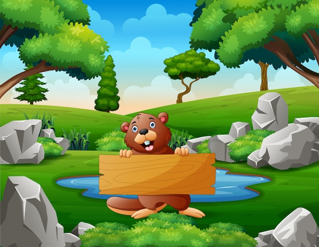 A beaver holding wooden sign near the small pond