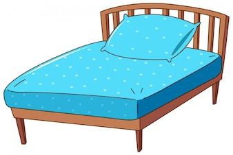 Bed with blue pillow and sheet