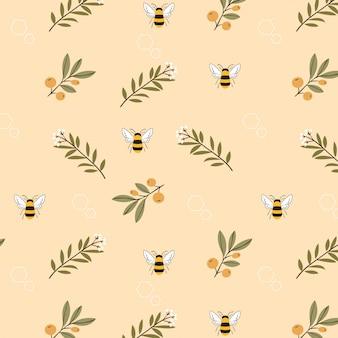 蜂と花の黄色の背景のシームレスパターン