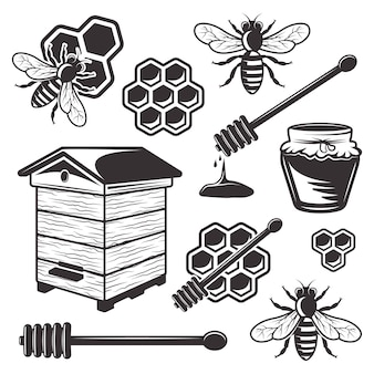 白い背景の上の黒いオブジェクトと要素の養蜂と蜂蜜のセット