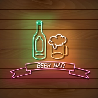 Beer bar neon light banner on a wooden wall. green and pink sign. decorative realistic retro element for web