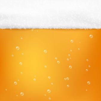 Пивной алкогольный напиток текстуры. холодное свежее пиво с пеной и пузырьками.