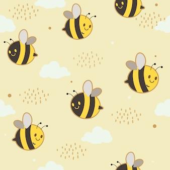 雲とドットのパターンで飛んでいる蜂