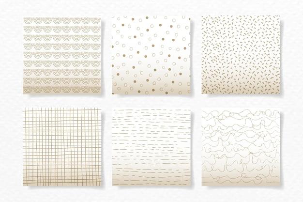 ベージュの抽象的なブラシのシームレスなパターンセット