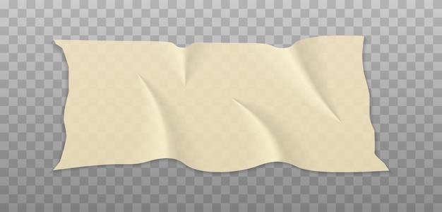 ベージュの接着剤またはマスキングテープ片
