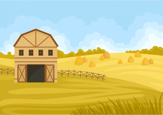 Beige barn with an open gate to the field with a haystack.