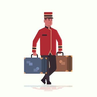 Колокол мальчик нося концепцию обслуживания чемоданов посыльный держа багаж мужской работник гостиницы в форме