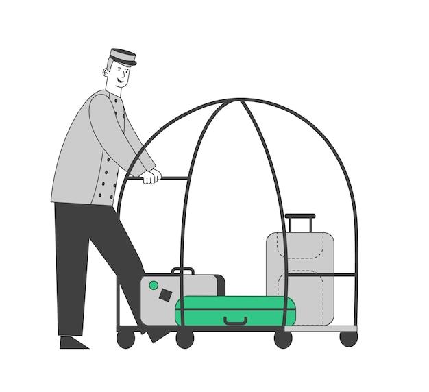 Посыльный или беллман толкает багажную тележку с чемоданами