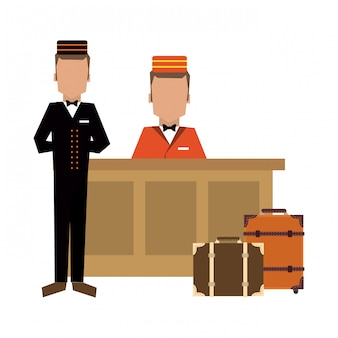 Bellboy with luggage at reception