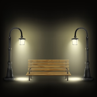 Bench illuminated by street lamps.