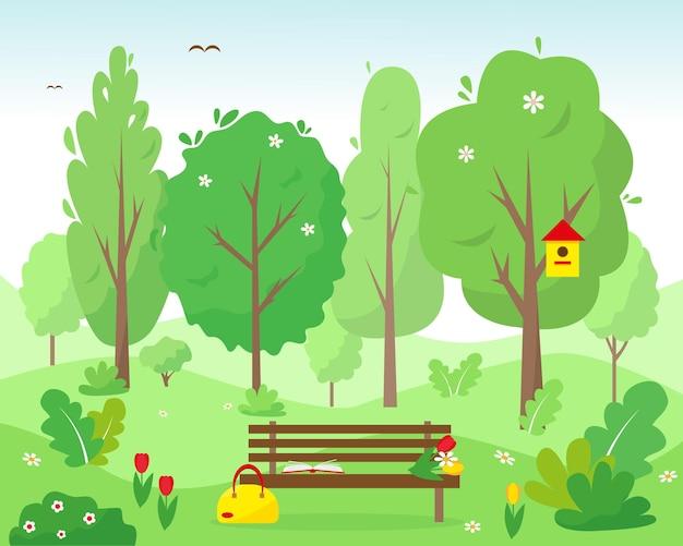 森や公園で本、バッグ、花のベンチ。春または夏の風景の背景または概念。