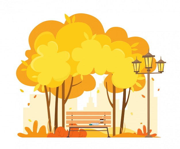 街の外の秋の公園で本とコーヒーのベンチ。