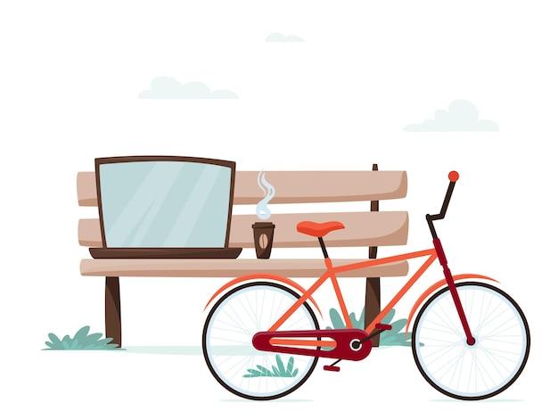 Скамейка с ноутбуком, кофе и велосипед в городском парке; фрилансер или студенческое рабочее место