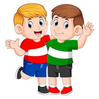 Best children friends standing with hand on shoulder