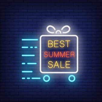 Best summer sale neon sign. Glowing text in frame, gift box on wheels in motion. Night bright advert