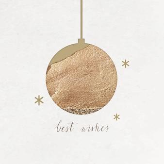 Iscrizione di auguri con pallina d'oro e stelle scintillanti