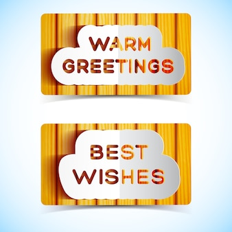 Best wishes and warm greetings signboards on wooden wall