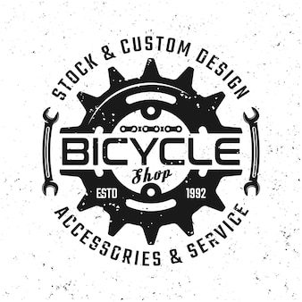 Bicycle gear vector round emblem, badge, label or logo in vintage style isolated on background with removable grunge textures