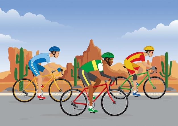 砂漠の背景が付いている道の自転車レース