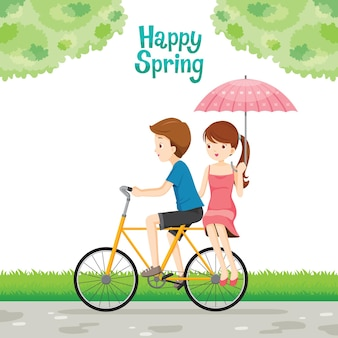 Bicycle rider man and woman with umbrella sitting behind